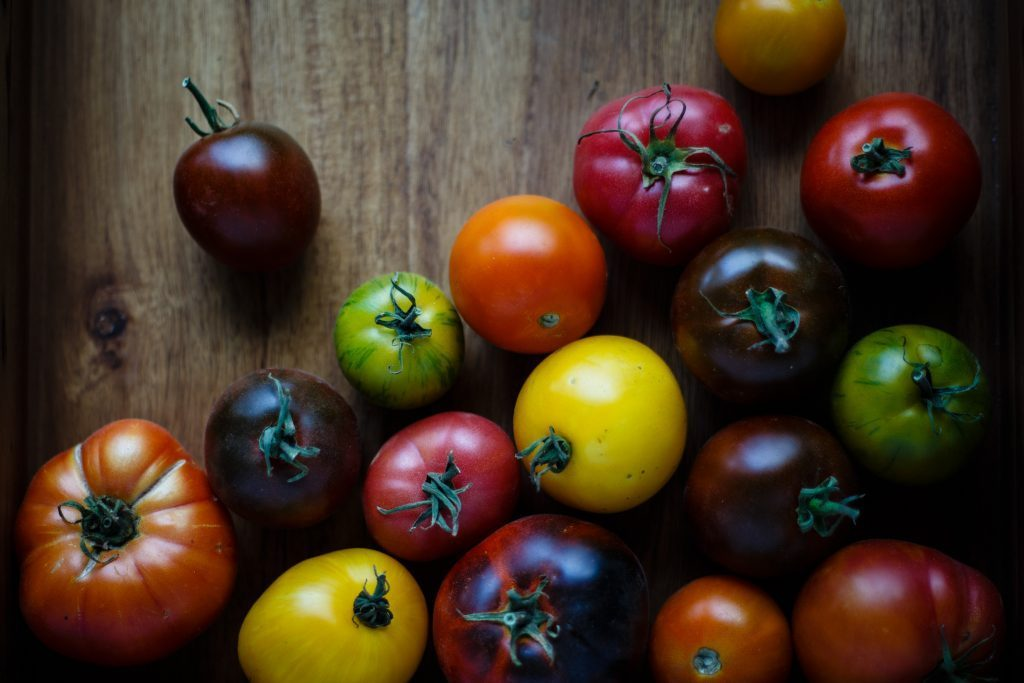 various sizes, shapes and colours of tomatoes
