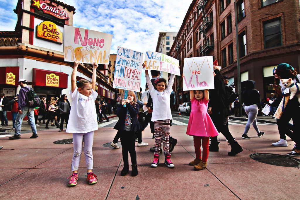 Children protesting and holding up signs