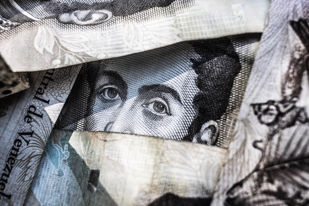 A pile of paper money with view of man's face